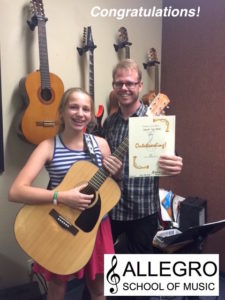 Congratulations to Guitar Student, Hannah for earning her Champion wristband! She studies with Instructor, Shawn Kebler!