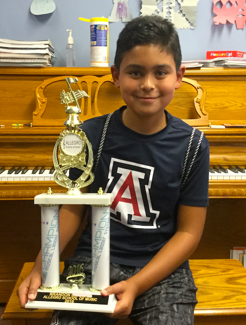 Congratulations to Brandon for earning his Champion Trophy! He has taken Piano Lessons at Allegro for FOUR YEARS and studies with Instructor, Louisa Muir.